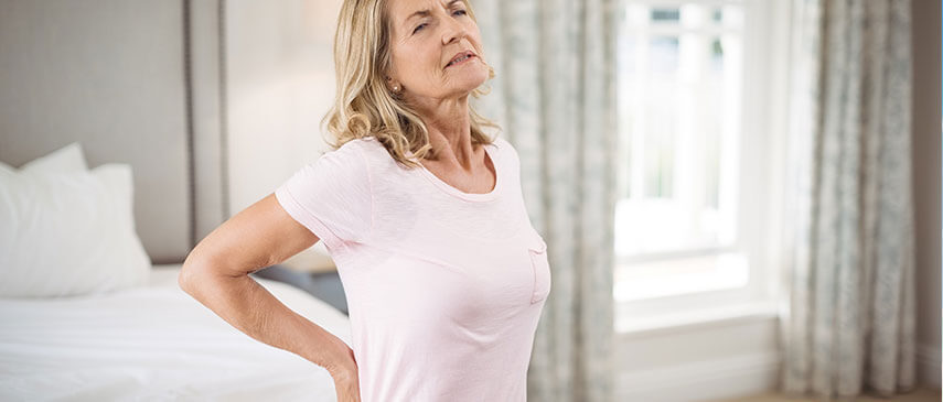 older female experiencing back pain
